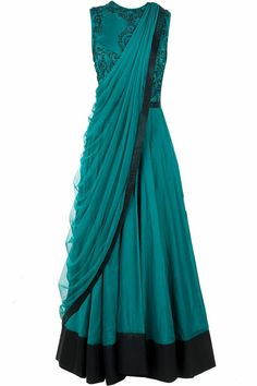 Green anarkali with draped dupatta.