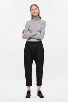COS image 1 of Drop-crotch wool trousers in Black