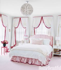 A former sleeping porch became a daughter's bedroom. Roberts hid blackout shades behind eyelet sheers on the three walls of windows, then added linen curtains trimmed in Lee Jofa's Portofino. Headboard and bed skirt in Sister Parish Design's Dolly, through John Rosselli & Associates.   - HouseBeautiful.com