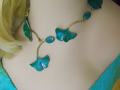Teal Turquoise Blue Ginkgo Leaf Necklace w/ Blue Jasper Stones by RenesJewelryArt. Use coupon code SUMMER for 10% off any purchase. Click here to visit my Etsy shop: https://www.etsy.com/shop/RenesJewelryArt?ref=hdr_shop_menu