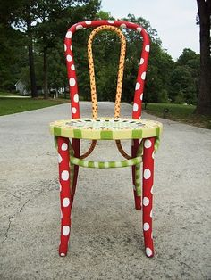 Another cool chair... something to get our Chair-ity artist's creative juices flowing! Painted bistro chair