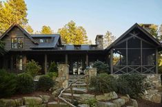 The stone steps and natural branch handrail. Whimsical lakeside cottage retreat with cozy interiors on Lake Keowee Lakeside Cottage, Lake Cottage, Rustic Cottage, Swedish Cottage, Lakeside Living, Cottage Style, Plan Chalet, Rustic Lake Houses, Rustic House Plans
