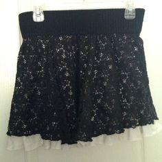 Flirty Black Lace Skirt Fun & flirty short black lace skirt with white cotton layer underneath. Gently used: Bought at Kohl's about a couple years ago, but only worn a few times. Size is XL, with an elastic waist. Fits juniors pants size approximately 9/10. Cute skirt for summer! Skirts