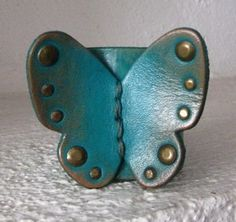 Hey, I found this really awesome Etsy listing at https://www.etsy.com/listing/68921335/leather-cuff-butterfly-bracelet-teal