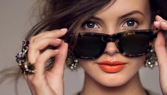 orange lips, inner corner highlight, slight crease definition, strong brows.