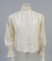 Woman's Blouse    Made in United States  c. 1905    Artist/maker unknown, American    Sized white cotton gauze, fillet lace and embroidery  Center Back Length: 16 inches (40.6 cm)