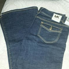 Michael Kors Jeans Brand new, never worn Pant leg is flared slightly more than a boot cut but not as wide as a traditional flare Deep blue wash  FINAL PRICE  NO TRADES MICHAEL Michael Kors Jeans