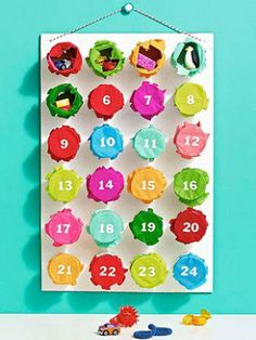Make your colorful advant calendar and Christmas countdown with toilet paper tubes, tissue paper, and little erasers.
