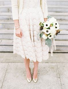 Winter bride with cardigan and anemone bouquet