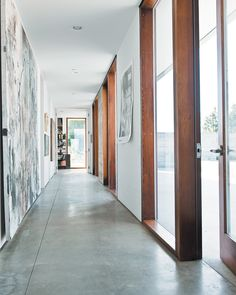 The long hallway leading to the bedrooms gets spectacular afternoon sun, lighting up the family's many works of art. Photo 10 of 18 in A Sonoma Prefab That Celebrates a Family's Passion for Cooking. Browse inspirational photos of modern homes. Long Hallway, Hallway Designs, Flooring Options, Big Houses, Concrete Floors, All Modern, Modern Design, House Design, Architecture
