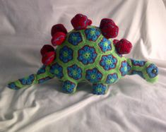 LanaGatto Crochet Dinosaur  Item details:  He is approx 27 inches long and 15 inches tall and the perfect size for cuddles. This dinosaur was made from yarn- 100% cotton or soft acrylic.  Filling: 100% hypoallergenic polyester Wash by hand. All parts securely sewn to the body.  I think that he will soon become your childs best friend and is perfect for a boy or a girl. This Dinosaur makes a great birthday present for anyone who loves stuffed animals I can make you a dinosaur in any colour…