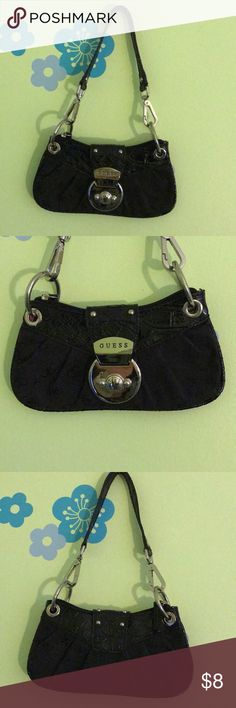 Guess mini bag Guess mini bag. Color- black. Patent leather and canvas. Beautiful!! Silver tone hardware. Gently loved, in great condition. Clean. 4.5 h x 8 w. Guess Bags Mini Bags