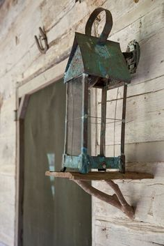 Photos: Cabin Fever | Garden and Gun this lantern is on a bracket!  Check the bracket!    YES!!!!!
