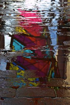 Reflection on the sidewalk in Modica Way, Massachusetts Ave. Cambridge, MA