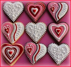 Making #heart shaped #cookies for #Valentine's day? These gorgeous examples will give you lots of inspiration for decorating yours with white, pink and red icing.