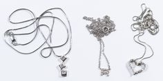 """Lot 177: 14k White Gold and Diamond Necklace and Pendant Assortment; Three necklace and pendant sets including a signet """"R"""" pendant, a heart pendant and a drop pendant, all adorned with round cut diamond chips; all marked"""
