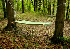 MY DIY HAMMOCK! <$15 since i had the wood and fabric already...one 2x4 cut in half, a full size flat sheet (i don't even have a full sized bed anymore!) folded over and staple gun I had at home...just bought the eye bolts and nylon rope...