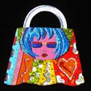 Mosaic artwork by Leslie Perlis. This is just an accessory...her full wardrobe of work is wow
