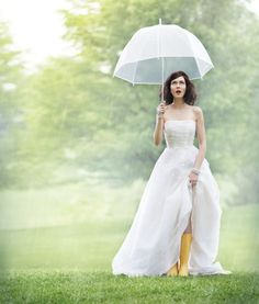 """March winds and April showers, will bring May flowers."" Who says rain on a wedding day is bad luck? We think this is great photograph opportunity! #rainboots #bride #springweddings"