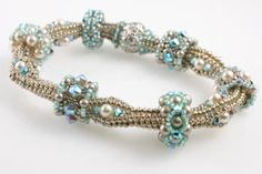 Using crystals and pearls, you'll create a variety of beautiful slider beads that are held in place with increased herringbone tubular bumps. Each versatile bead will fit on the bracelet with just the Bracelet Crochet, Beaded Bracelet Patterns, Beaded Necklace, Beaded Bracelets, Beaded Bead, Pandora Bracelets, Ideas Joyería, Seed Bead Jewelry, Seed Beads