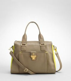 Pre-owned pebbled leather satchel in clay and yellow color. Front exterior pocket with 3 interior pockets. The back of the handbag has slight color transfer from denim on the handle and bottom portion of the bag as seen in the photos. Otherwise the rest of the handbag is in excellent condition. Dust bag is included.