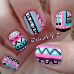 Aztec / tribal nail art design in bright blue, purple, white and pink
