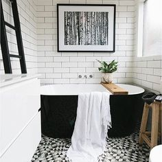 I live this tub. Beautiful black and white bathroom with white subway tiles, black grout, graphic geometric patterned floor, black freestanding bathtub and modern fine art photography. Bad Inspiration, Bathroom Inspiration, Bathroom Inspo, Bathroom Goals, Bathroom Colors, Bathroom Designs, Black White Bathrooms, Black And White Bathroom Ideas, Bathroom Black