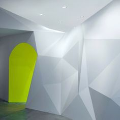 This beauty salon with faceted walls is located within a hotel in central Singapore.