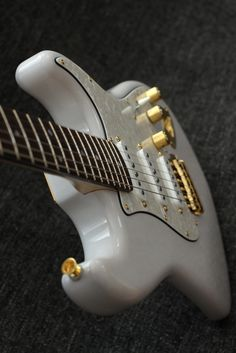 Straotocaster style hand made guitar with hand made pickups.