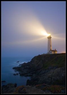 Light beams from a lighthouse