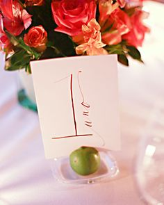 Table Numbers in Spanish with lime wedge