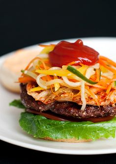 Korean burgers with Sriracha - one of my favorite recipes. The brown sugar, ginger and cucumbers make it the best burgers I've ever had. (that is not a dare)