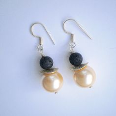 Black lava and golden pearls dangle earrings