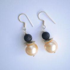 Black lava and golden pearls dangle earrings