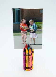 Crayon photo holder - For a unique way to display your child's first day of school picture, here's a fun project that you can do with your child to get them even more excited about back to school. This also makes a great teachers' gift. Or decoration for a #backtoschoolfeast You can print your photos on the KODAK MOMENTS App and create a display of each year. #photography