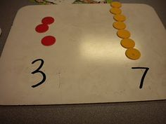 Concrete visual for remediation: comparing numbers, use two way counters or better yet, base ten blocks. Numbers Kindergarten, Math Numbers, Kindergarten Activities, Teaching Math, Maths, Teaching Ideas, Preschool, Math Skills, Math Lessons