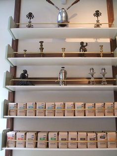 Brass railed shelving at Stumptown Coffee in NYC. Could use brass curtain rods from original owners. Shop Interior Design, Retail Design, Cafe Design, Design Design, Coffee Display, Brass Curtain Rods, Filter Coffee Machine, Opening A Coffee Shop, Cafe Bistro