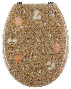 in den transparenter beigebraunen wc sitz aus polyresin sind muscheln und sandkiesel eingegossen der