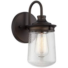 This outdoor wall sconce is a great addition to a porch or patio area. A rustic bronze finish gives this fixture a lovely old-fashioned vibe. The clear seeded glass shade has rounded edges for a softer look. Perfect for use with a decorative light bulb. Cabin Lighting, Outdoor Wall Lighting, Wall Sconce Lighting, Cottage Lighting, Lighting Ideas, Dimmable Light Bulbs, Light Bulb Wattage, Bronze Wall Sconce, Sconces