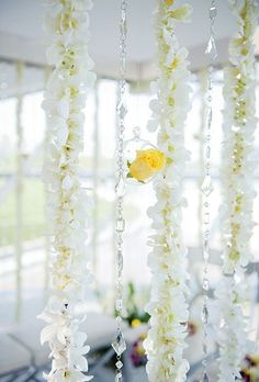 hanging orchids and crystal curtain on the tent