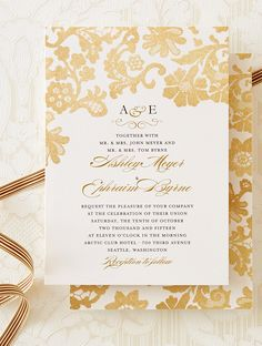 Lace detail on this wedding invitation is accented by metallic inspired designs.