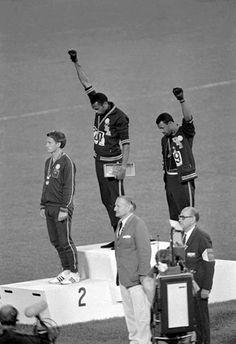 """Winners of the 200 meters at the Mexico Olympics 68, greeting """"black power"""" in the awarding of medals / Ganadores de los 200 metros en la olimpiada México 68, saludo """"black power"""" en la entrega de medallas."""