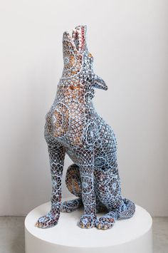 By Artist Joana Vasconcelos whose Animal Sculptures are covered with mathematically complex hand crochet patterns.