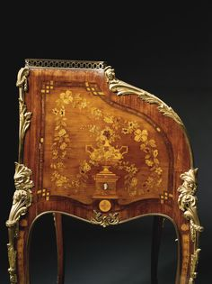 A TRANSITIONAL STYLE GILT BRONZE MOUNTED KINGWOOD, STAINED AND PEN-WORKED FRUITWOOD MARQUETRY CYLINDER DESK AFTER A MODEL IN THE JONES COLLECTION AT THE VICTORIA AND ALBERT MUSEUM Paris, circa 1895, possibly Paul-Charles Sormani (b. 1848) or Henry Dasson (1825 - 1896)