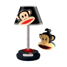 """Paul Frank Table Lamp and Projection Clock Radio. Decorate any room for any age with these fun and trendy Paul Frank items. With it's Signature Colors, Julius really stands out making a great fun environment. Projection Clock-Lens Adjusts 120 Degrees to Project Time and Julius Face on to the Wall or Ceiling * 0.6"""" Red LED Time Display * Easy-to-access Snooze Button * Sleep Function * AM/FM Radio with Thumb Wheel Tuning * Wake to Radio or Alarm * Unit Dimensions: 6.3""""(W) x 5.7""""(H) x..."""