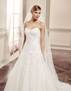 SIDNEY // This beautiful A-line wedding gown made from dreamy tulle with beaded lace over a fitted bodice is a classic dress for the aisle