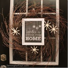 DIY Winter Wreath Tutorial made with yarn snowflakes and a pretty framed winter printable!