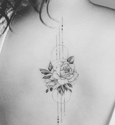 For someone who wants something less heavy but still striking, check out this geometric rose back tattoo, which has brilliant dotwork. Find more Tattoo Ideas at CafeMom.com. #tattoos #tattoodesign #tattooideas