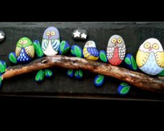 Unique birds wall art made of rivers stones in beautiful variety of blue color. A great gift for new home house warming gift or for any bird lover. Suitable for nursery, bedroom or living room decor. Made of rivers stones, pebbles and dry twig found on the beaches Size: 40 cm x 30 cm / approx 16 x 12 /  The picture is ready to hang on the wall.   Once marked as shipped your order will be delivered approx within: United States: 2-6 weeks Europe: 2-4 weeks Canada: 3-6 weeks Australia...