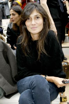 Emmanuelle Alt-natural.  no makeup and so chic.  hermes medor cuff of course.